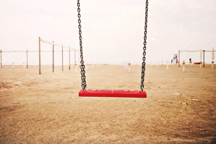 Empty swing against sky in park