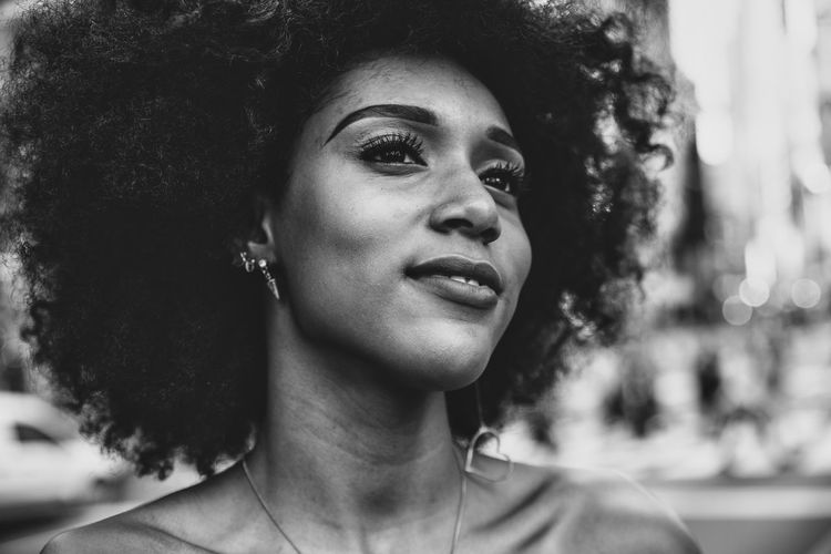 Thoughtful Young Woman With Afro Hairstyle In City