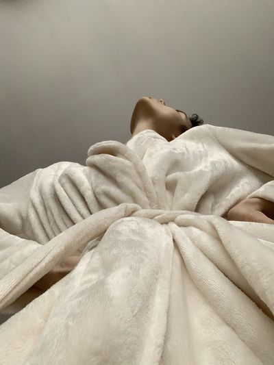 Low angle view of woman wearing robe against ceiling