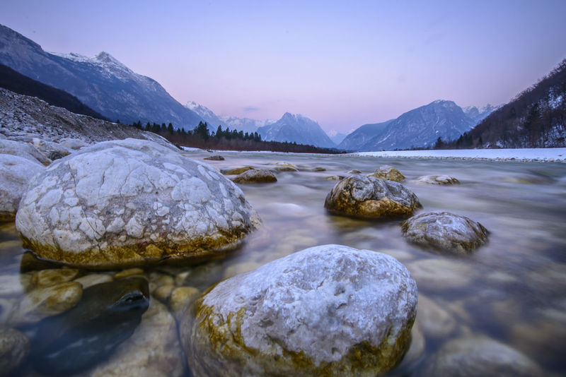Beauty In Nature Bovec Clear Sky Dawn Foreground Landscape Landscapes Landscapes With WhiteWall Nature No People Non-urban Scene Outdoors River Rock Rock - Object Scenics Slovenia Soca River Sunset Tourism Tranquil Scene Travel Valey Water