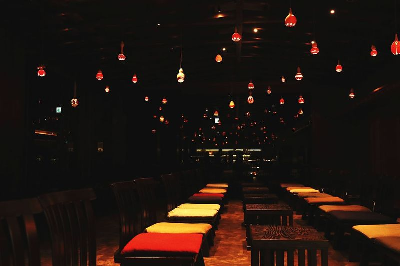 Japanese Culture Japan Copy Space Backgrounds Illuminated Lighting Equipment No People Indoors  Night Seat In A Row Chair Architecture Light Empty Large Group Of Objects Table Electric Light Business Orange Color Celebration Glowing Decoration Nightlife