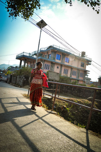 Culture And Tradition Full Length Outdoors Moving Forward  WalkingEyeEm Masterclass Eyeem Philippines Warm Clothing Red People Photography Travel Travel Photography Woman Of Nepal Traditional Nepalee Clothes For Women Traditional Clothing Nepal Shadows Shadows & Lights