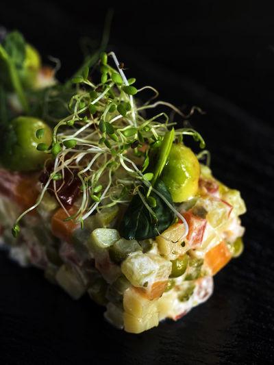 Close-up of olivier salad served on slate