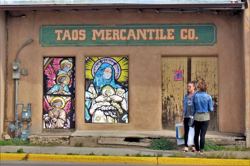 Exterior of Taos Mercantile Co. Adobe ArtWork Customers Graffiti Graffiti Art Iconography Lingering Loitering New Mexico Southwest  Storefront Taos Taos Mercantile Tourist