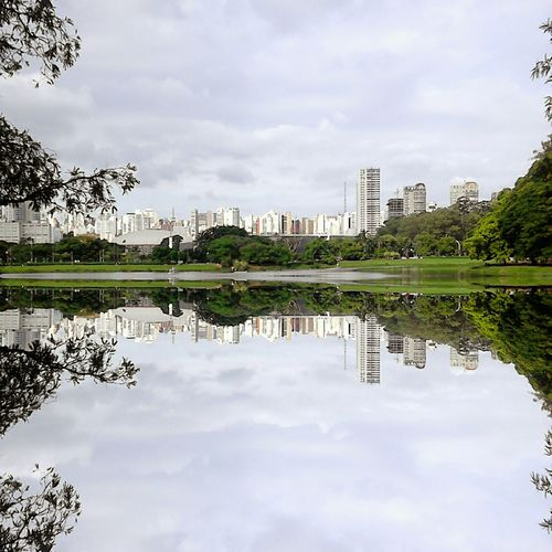 Reflection Cloud - Sky Water Sky Lake Outdoors Day No People Travel Destinations City Tranquility Scenics Nature Symmetry Architecture Urban Skyline Modern Tree Beauty In Nature
