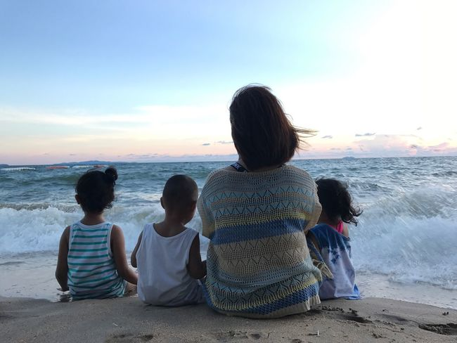 Sea Beach Childhood Children Family Horizon Over Water Sand Water Sitting Boys Rear View Real People Shore Sky Men Girls Sunset Scenics Son Leisure Activity Lifestyles Happy Happiness