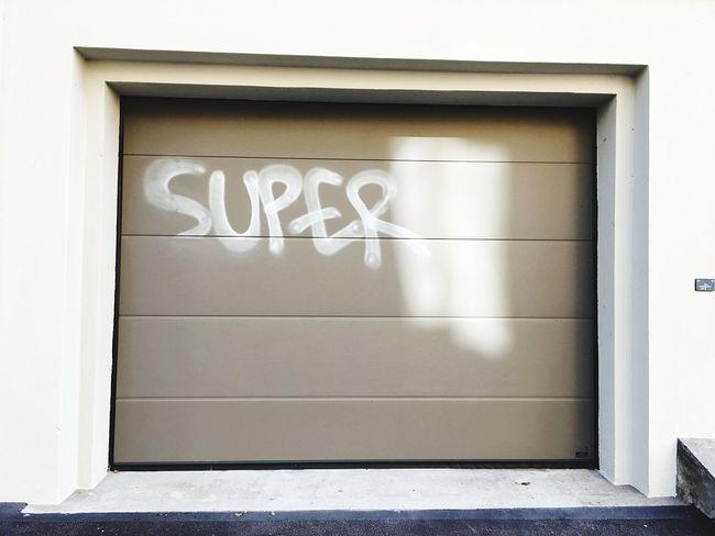 Super Garage Garage Door Door Graffiti Text Architecture No People Built Structure Day