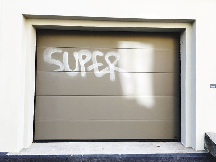 Super Garage Garage Door Door Graffiti Text Architecture No People Built Structure Day