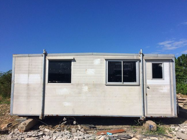 camper of construction in bangkok Thailand Ruins Building Exterior Day Outdoors Architecture Built Structure Blue Camp Campers Camper Construction Construction Site Bluesky Blue Sky Sky Landscape Building Site Windows Door The Graphic City