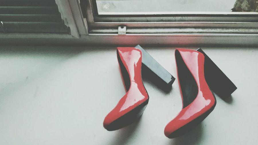 High angle view of heels on window sill