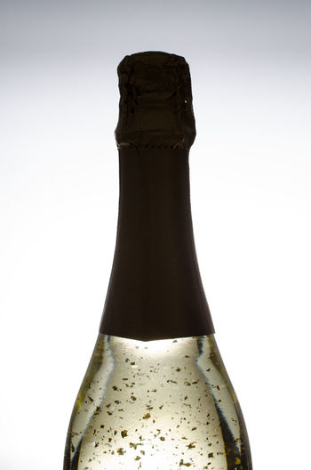 Bottle of champagne with beaten gold Alcohol Beatgold Bottle Champagne Close-up Cork - Stopper Day Drink Foilage Food And Drink Freshness Gold Indoors  No People Sparkling Wine Studio Shot White Background Wine Wine Bottle Wine Cork