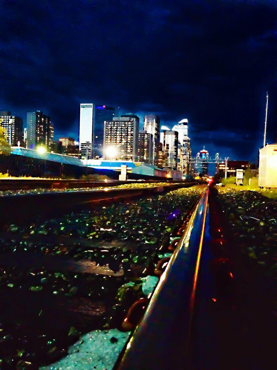 illuminated, night, architecture, building exterior, built structure, city, skyscraper, cityscape, city life, outdoors, transportation, no people, modern, travel destinations, sky, urban skyline