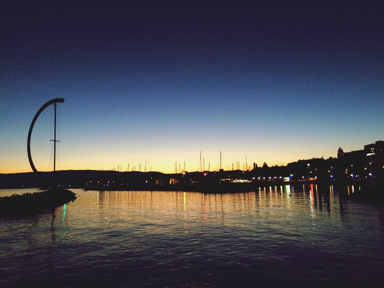 water, nautical vessel, waterfront, reflection, nature, sunset, outdoors, transportation, silhouette, clear sky, sea, moored, no people, sky, mast, sailboat, beauty in nature, scenics, architecture, yacht, day