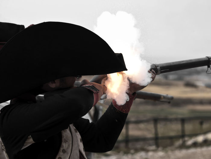 Fire! Day Firing  Headwear Holding Men Military Musket Musketeer Musketeers One Person Outdoors People Real People Shooting Sky Smoke - Physical Structure Weapon