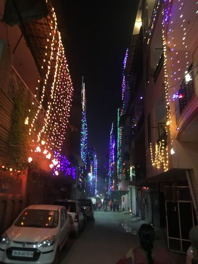 Illuminated Night Christmas Building Exterior Celebration Architecture Built Structure Car Christmas Decoration Land Vehicle Christmas Tree Christmas Lights Transportation Real People City Men Outdoors Sky One Person People Diwali Diwalicelebrations