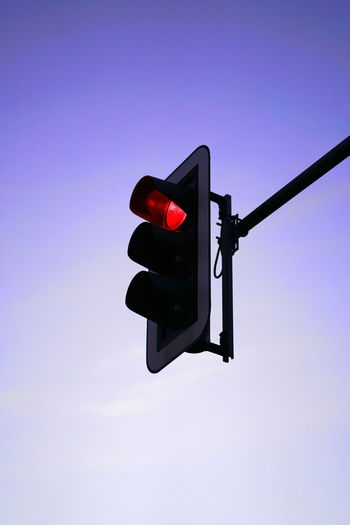 Stoplight Sign Light Road Signal Guidance Sky Red Light Illuminated Safety No People Communication Low Angle View Red Outdoors Nature Direction Lighting Equipment Day Road Sign Copy Space