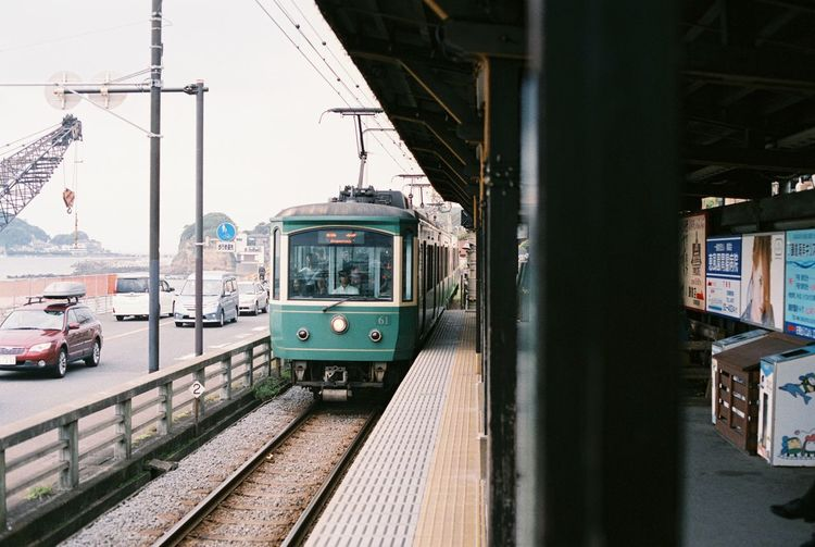 Analogue Photography Cable Car City Life Enoden Film Film Photography Filmisnotdead Filmphotography Japan Journey Kamakura Land Vehicle Mode Of Transport Narrow Public Transport Rail Transportation Railroad Station Railroad Track Street Train Train - Vehicle Train Arriving In Station Sunset Train Station Tramway Transportation