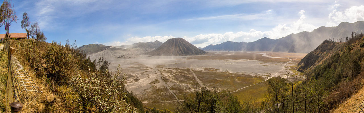 Panorama - sand storm over the volcanic landscape of Mount Bromo, Indonesia ASIA Beauty In Nature Bromo Bromo Mountain Cloud - Sky Day Desert INDONESIA Landscape Nature No People Outdoors Panorama Sand Storm Scenics Tourist Travel Travel Destinations Volcanic Landscape Volcano