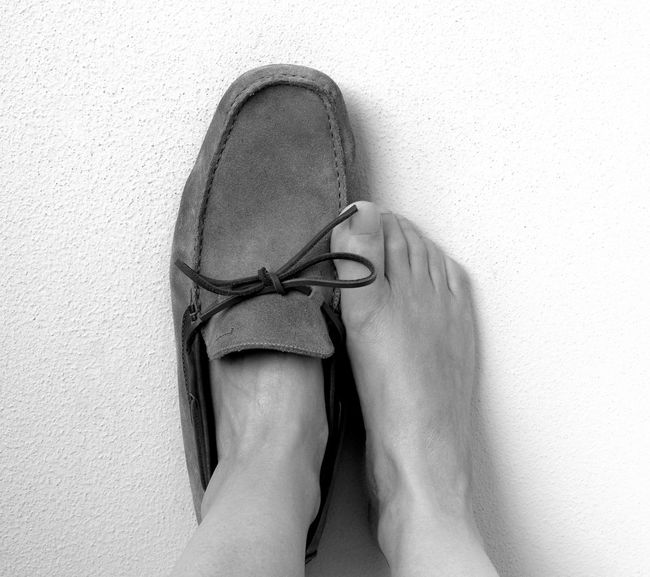 Adult Blackandwhite Close-up Day Feet Feet Against A Wall Human Body Part Human Leg If I Were In Your Shoes Indoors  Low Section One Person Out Of The Box People Real People Shoe Simplicity Standing Too Big Women