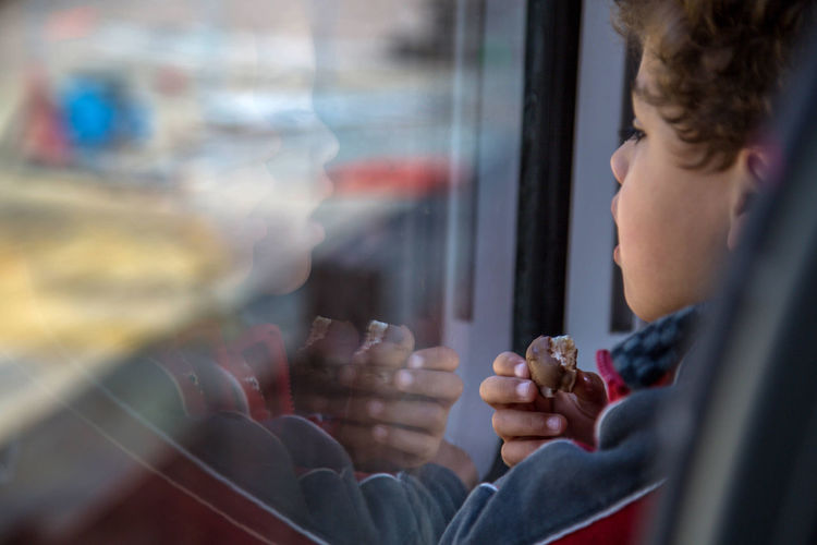 Boy Candid Chocolate Close-up Feel The Journey Lifestyles Part Of Train Traveling Window Window Reflections