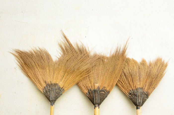 old broom or besom on the gray wall Cleaning Household Household Chores Housekeeping Housework Trash Besom, Broom Broomstick Brown Brush Brushwood, Clean Cleanup, Domestic, Equipment Group Housecleaning Household Equipment Many Object Straw Sweep, Sweeping Tool