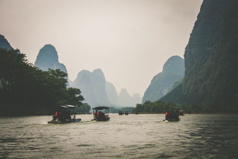 Sailing in a River. China. Adventure. EyeEm Ready   Yangshuo Travel Destinations Transportation Sailing Boats Outdoors Nature Mountains Inspirational Moment China Beauty In Nature Adventure Time Wanderlust The Week On EyeEm Foggy Weather The Great Outdoors - 2018 EyeEm Awards