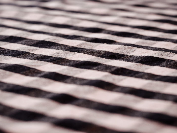 Pattern Full Frame Backgrounds No People Selective Focus Textured  Checked Pattern Indoors  Black Color Repetition Close-up Flooring Striped Textile White Color Architecture High Angle View Design Day Sunlight Tiled Floor Surface Level