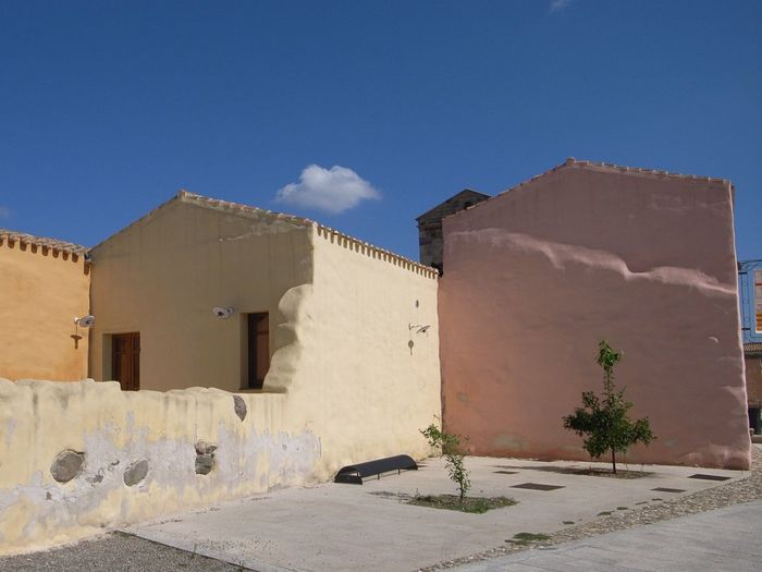 Blue Sky Summertime Small Town Outdoor Photography Daylight Travel Photography Italy Sardegna Sardinia Sardegna Italy  Tourism Colors Architecture Building Building Exterior Cloud - Sky Courtyard  Day House No People Outdoors Sky Sunlight Wall Housing Settlement Urban Scene Residential Structure TOWNSCAPE Outside