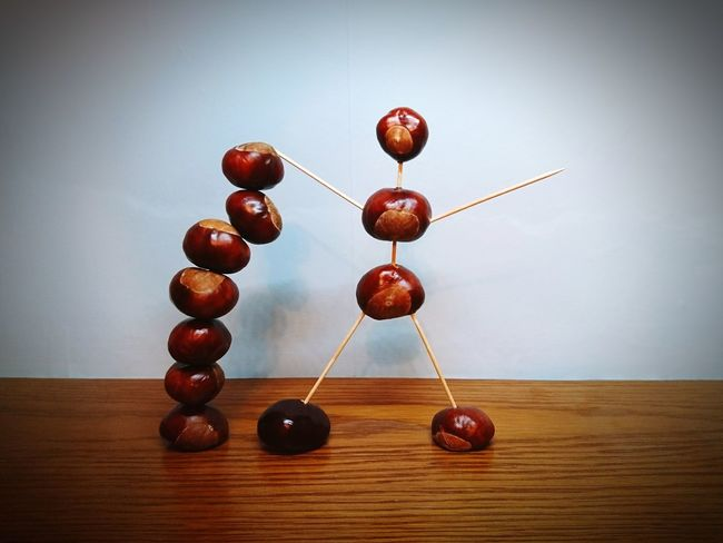 Conker man balancing some conkers 😂 No People Still Life Wood - Material Close-up Indoors  Conker Season Conker Man Playtime Invention Artistic Photo Experimental Brown Brown Colour Shades Shades Of Brown Wooden Texture