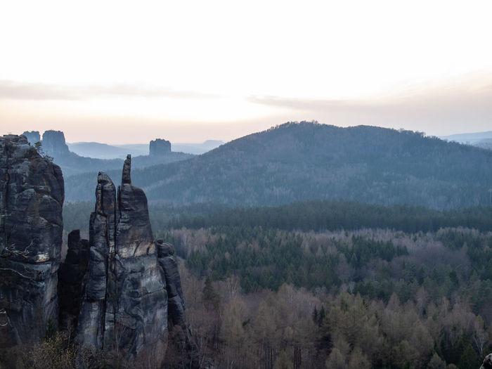 Rocks at blosstock  and far falkenstein seen from affensteine viewing point in saxony switzerland
