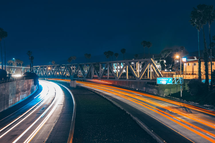 Industrial Scenery Illuminated Night Light Trail Long Exposure Architecture Transportation Motion City Built Structure Street Speed Road Sky The Way Forward Building Exterior Direction Lighting Equipment Connection No People Blurred Motion Bridge - Man Made Structure Outdoors Diminishing Perspective Light