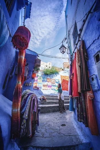 """""""The Blue City"""" - Chefchaouen, Morocco. Chefchaouen Chefchaouen Medina Medina Morocco MoroccoTrip EyeEmNewHere a new beginning Digital Nomad Travel Travel Destinations Traveling Travel Photography Photography Blue City Alley Maze Arabic Moroccans Tourism Tourist Attraction  Tourist Destination Architecture Built Structure Building Exterior Retail  Sky Hanging Day Market No People Nature Choice Direction For Sale The Way Forward Street Outdoors Cloud - Sky Variation Market Stall Street Market"""