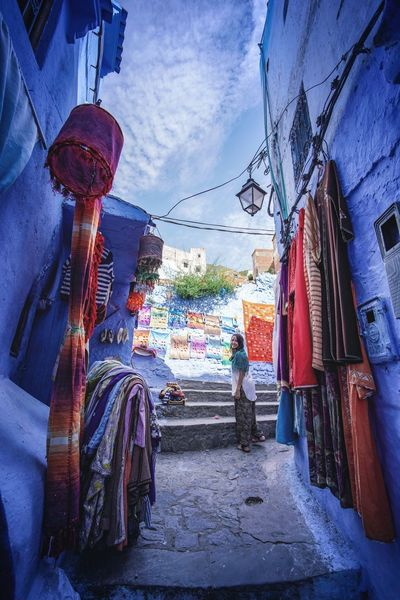 """The Blue City"" - Chefchaouen, Morocco. Chefchaouen Chefchaouen Medina Medina Morocco MoroccoTrip EyeEmNewHere a new beginning Digital Nomad Travel Travel Destinations Traveling Travel Photography Photography Blue City Alley Maze Arabic Moroccans Tourism Tourist Attraction  Tourist Destination Architecture Built Structure Building Exterior Retail  Sky Hanging Day Market No People Nature Choice Direction For Sale The Way Forward Street Outdoors Cloud - Sky Variation Market Stall Street Market"