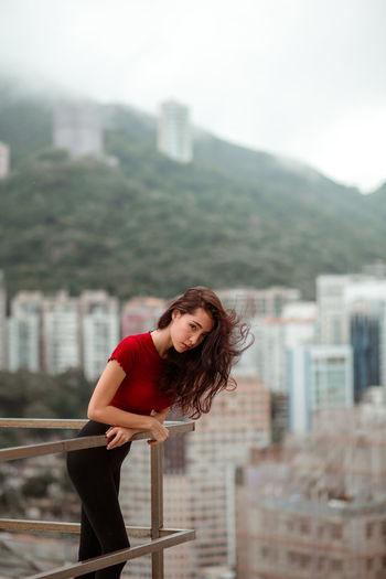 jade Portrait Portrait Of A Woman Portrait Photography Beautiful Woman Beautiful People Wind Mountains Hong Kong City Young Women Beautiful Woman Portrait Women Red Beauty Beautiful People Standing Sky Cityscape Urban Scene
