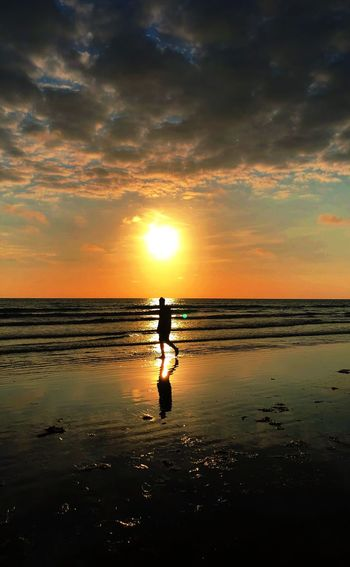 10 Sky Water Sea Sunset Beach Real People 10 Scenics - Nature Land Beauty In Nature Horizon Over Water Cloud - Sky Horizon Orange Color Reflection One Person Lifestyles Men Tranquility Silhouette Sun 10 10