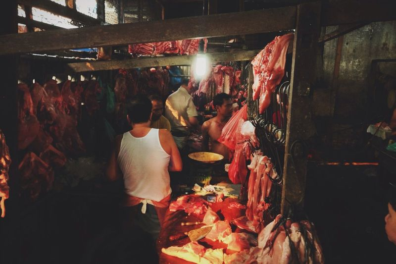 Butchers At Slaughter House Of Meat Business