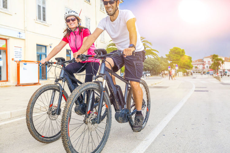Couple on holiday with electric bicycles Couple Croatia E-bike Holiday Recreation  Rovinj Activity Bicycle Bike Cycling E-mountain Ebike Happiness Istria Lifestyles Mountainbike Pedelec Pula Smiling Sports Summer Togetherness Tour Transportation Vacation