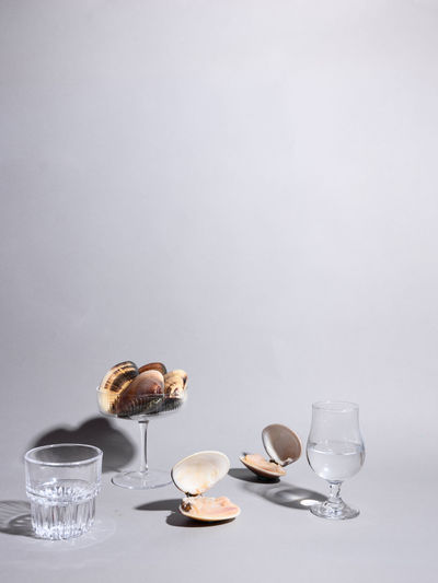 Wine glasses on table against white background