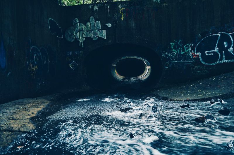The Great Outdoors - 2017 EyeEm Awards The Street Photographer - 2017 EyeEm Awards The Architect - 2017 EyeEm Awards Urban Indoors  New York City Landscape Water Tunnel City Blur Shadow Modern Moody Architecture Colors New Jersey Lake GatesOfHell Canals And Waterways Canal Wall Built Structure Long Exposure Waterscape