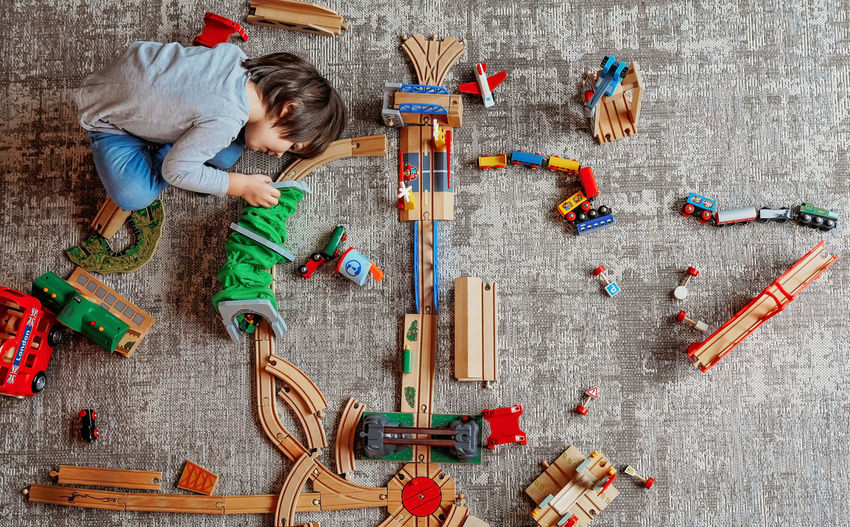 High angle view of girl playing with toy on floor
