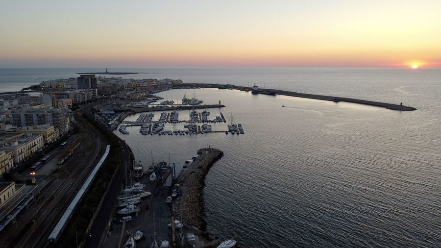 High angle view of beach against sky during sunset