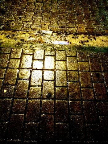 Full Frame Pattern No People Outdoors Water Night Rain Road Sidewalk Ground Yellow Black Rain In The City Street Waiting For The Bus Vivid Light Lights Brick Pattern Pieces EyeEmNewHere