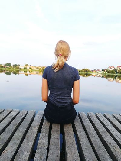 Blond Hair One Woman Only Rear View Water Adult Only Women Lake Human Body Part One Person Women People Adults Only Day Leisure Activity Outdoors Young Adult Young Women Sitting Sky Nature First Eyeem Photo