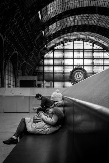 Two people alone waiting in Orsay Museum. Orsay Paris, France  Black And White Clock Indoors  Multi Colored Real People Sitting Time Two People