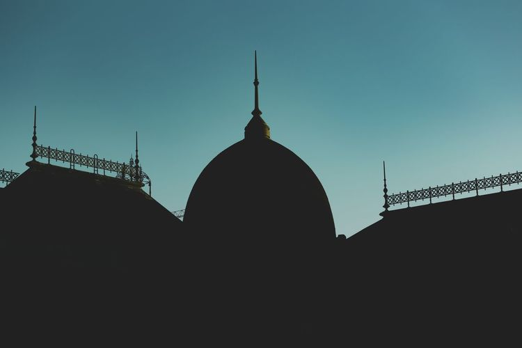 Low angle view of silhouette cathedral against sky