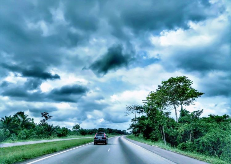Car Road Driving Cloud - Sky Storm Highway Traffic Transportation Tree Dramatic Sky Street Storm Cloud Travel Social Issues Torrential Rain Nature Car Point Of View Green Color Hurricane - Storm Cyclone Perspectives On Nature EyeEmNewHere