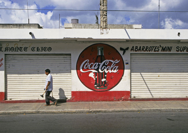 street scene in Cozumel Island, Mexico Architecture Building Closed Coca Cola Sign Cozumel Day Island Man Mexico One Man Only One Person Outdoors People Shop Store Street Street Life Supermarket Text Town Walking Yúcatan