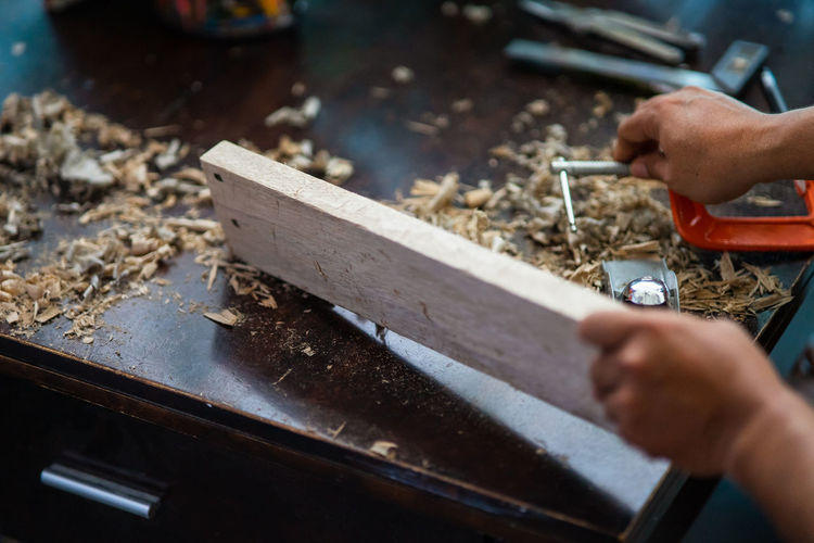 Person working on wood