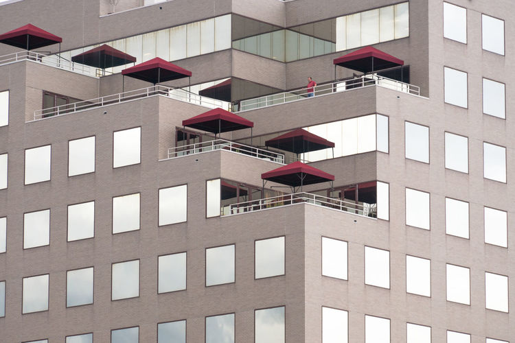 Low Angle View Of Red Umbrellas On Building