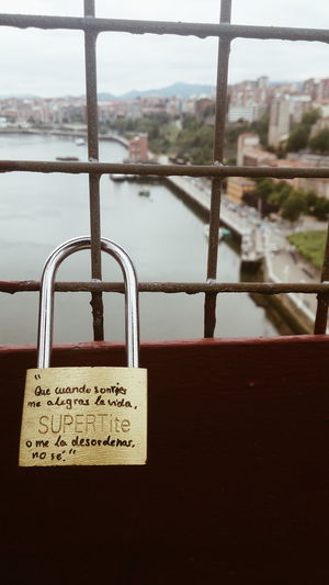 Romantic message in lock on the suspension bridge of Portugalete Bridge City Close-up Day Focus On Foreground Information Information Sign Lock Love Message Metallic No People Outdoors Romantic Selective Focus Sky Text